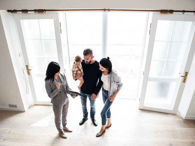 family-viewing-apartment-with-leasing-agent.jpg