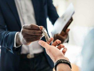 real-estate-agent-handing-over-keys.jpg