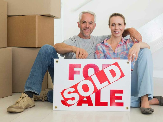 couple-with-sold-sign.jpg