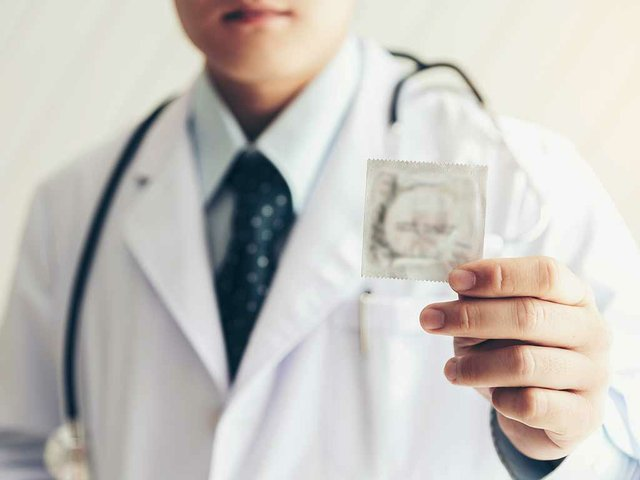 doctor-holding-condom.jpg