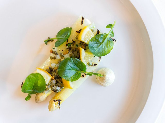 Grilled_White_Asparagus_-_Preserved_Meyer_lemon,_watercress_salad_and_pine_nut_caper_relish_photo-by-City-Foodstes.jpg