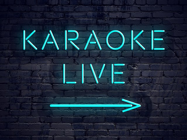 brick-wall-with-neon-arrow-sign-karaoke-live.jpg