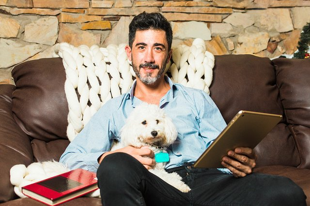 portrait-man-sitting-sofa-with-his-white-dog-holding-digital-tablet-hand.jpg