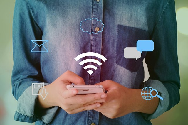 wifi-digital-network-data-icon-hand-using-smart-phone-background.jpg