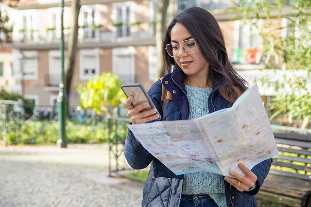 content-woman-using-paper-map-smartphone-outdoors.jpg