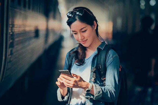 asian-woman-traveling-with-mobile-phone.jpg