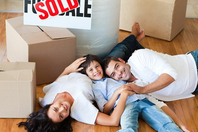 smiling-family-their-new-house-lying-floor.jpg