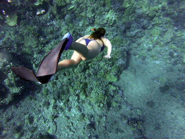 snorkeling-woman-swimming-in-the-sea-Photo-by-Mari-Martin-on-Unsplash.jpg