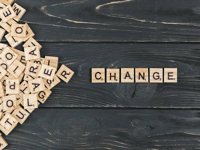 change-word--wood-letters-wooden-background.jpg
