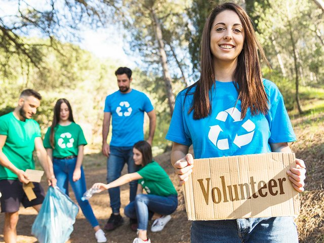 ecology-volunteers-collecting-trash-forest.jpg