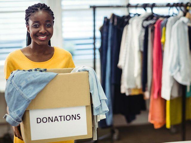 female-volunteer-holding-clothes-donation-box(1).jpg