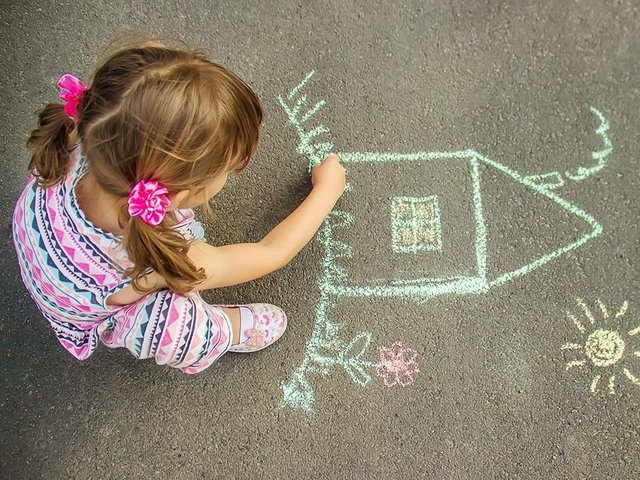 child-draws-house-with-chalk-asphalt-selective-focus.jpg