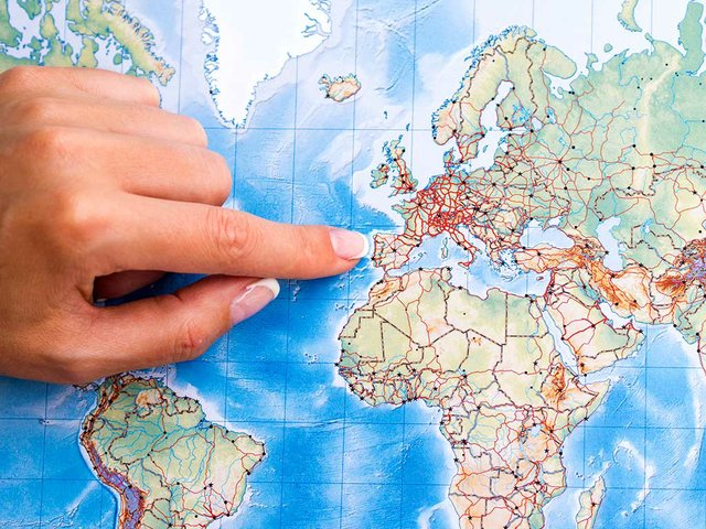 top-view-woman-hand-pointing-place-map.jpg