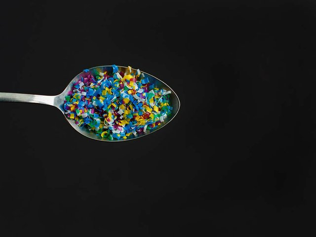 color-microplastic-spoon-black-background.jpg
