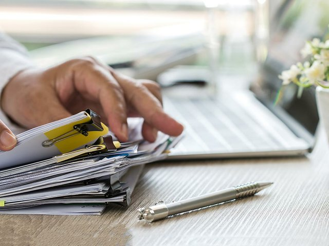 businessman-hands-holding-pen-working-stacks-paper-files-searching-informatio.jpg