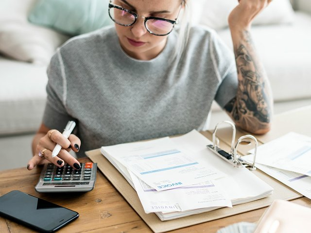 caucasian-woman-with-invoice-bills.jpg
