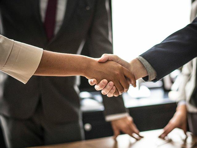 business-people-shaking-hands-meeting-room.jpg