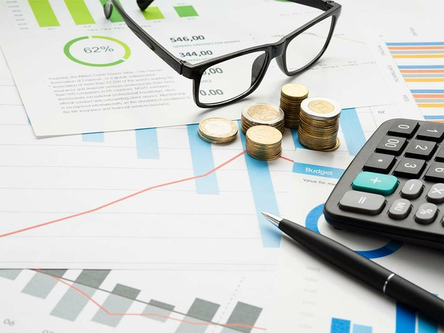 close-up-financial-instruments-with-glasses.jpg
