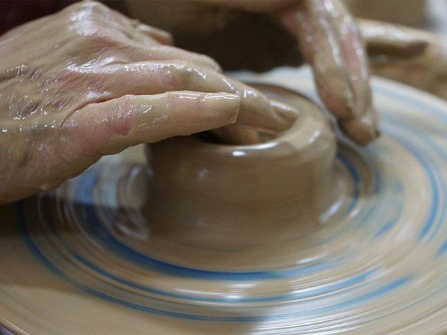 hands-working-on-the-potters-wheel.jpg