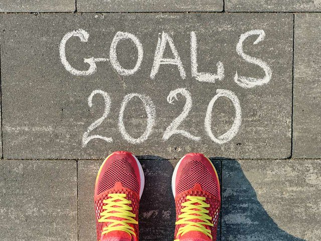 2020-goals-written-gray-sidewalk-with-woman-legs-sneakers.jpg