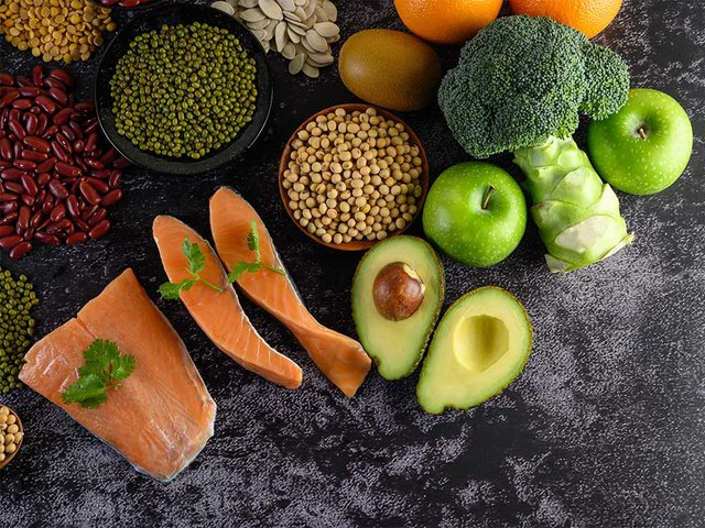 legumes-broccoli-fruit-salmon-placed-black-cement-floor.jpg