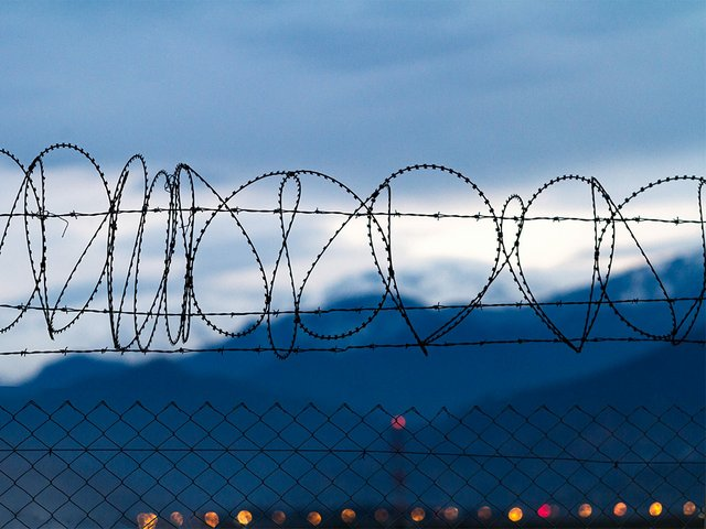 barbed-wire-mountains-background-evening.jpg