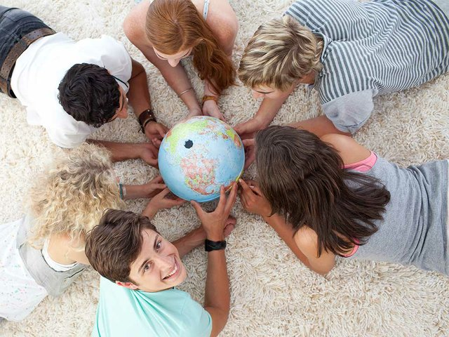 group-teenagers-floor-examining-terrestrial-world.jpg