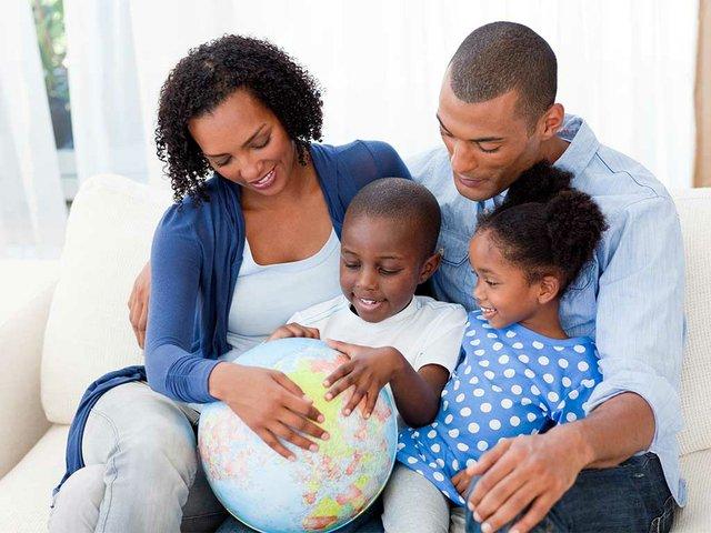 happy-family-holding-terrestrial-globe.jpg