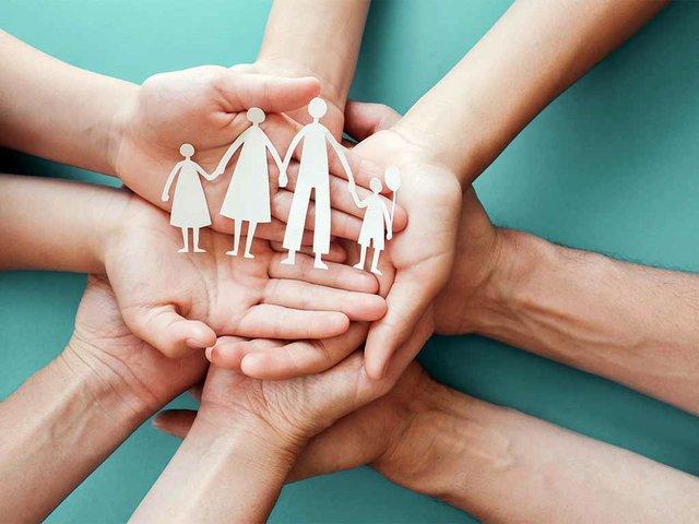 adult-children-hands-holding-paper-family-cutout(1).jpg