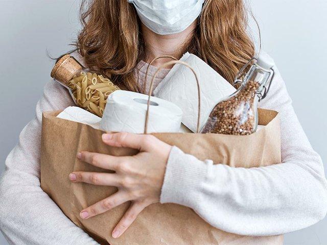 consumer-buying-panic-about-coronavirus-covid-19-concept-wom.jpg