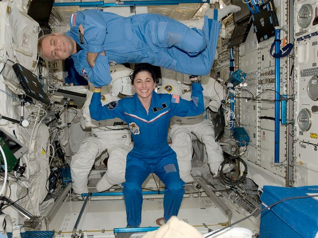 NASA-astronaut-Nicole-Stott-and-Russian-cosmonaut-Maxim-Suraev,-both-Expedition-21-flight-engineers,-pose-for-a-photo-in-the-Columbus-laboratory-of-the-ISS-(CC-BY-NC-2.0(.jpg