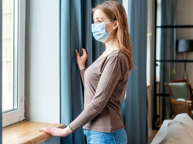 woman-with-mask-quarantine-looking-windows.jpg