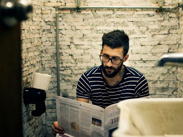 man-restroom-reading-newspaper.jpg
