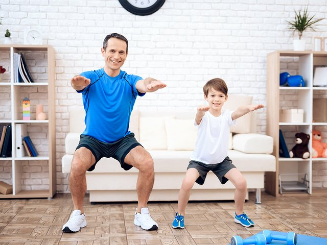 happy-father-son-warm-up-squats-home.jpg