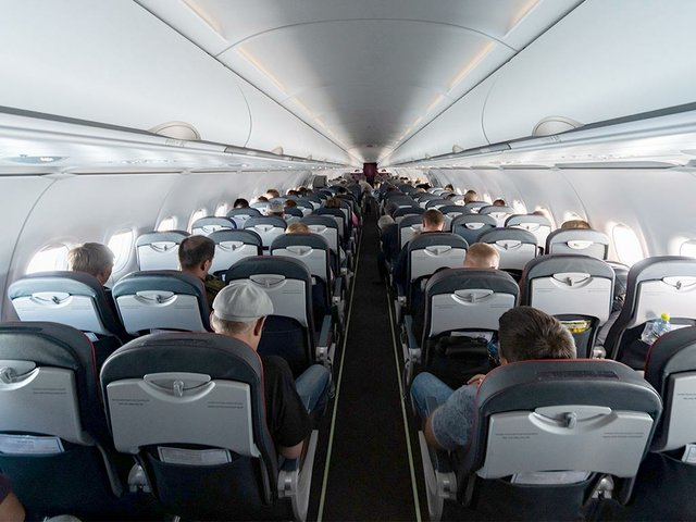 airplane-cabin-seats-with-passenge.jpg