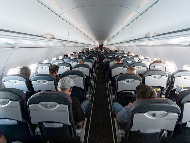 airplane-cabin-seats-with-passenge.jpg