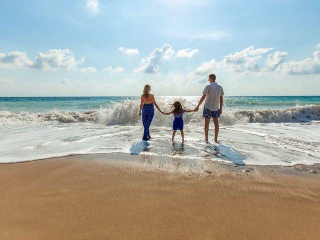 Family-on-the-beach-natalya-zaritskaya.jpg