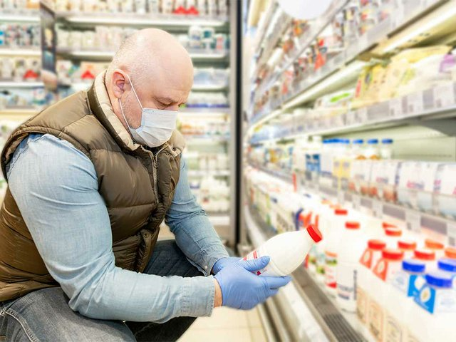 bald-man-medical-mask-chooses-dairy-products-supermark.jpg