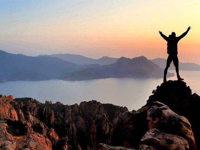 man-hiker-in-mountains-happy-sunset.jpg