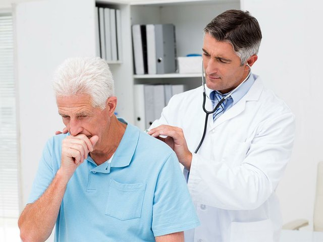 doctor-examining-coughing-senior-patient.jpg
