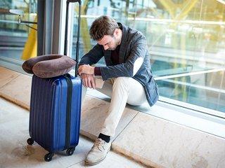 man-upset-sad-angry-airport-his-flight-is-delayed.jpg