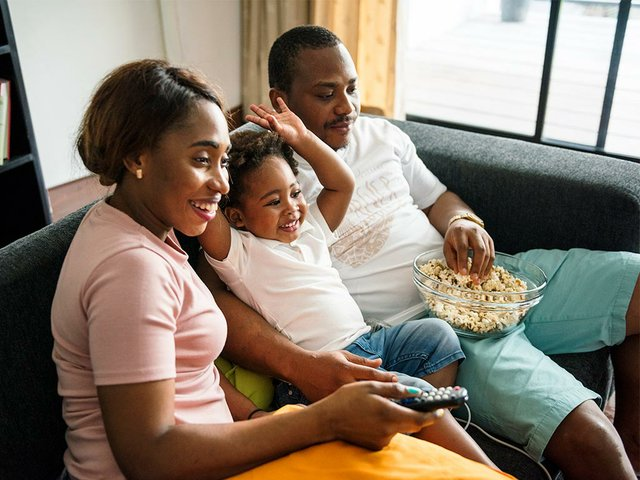 family-eating-popcorn-while-watching-movie-home.jpg