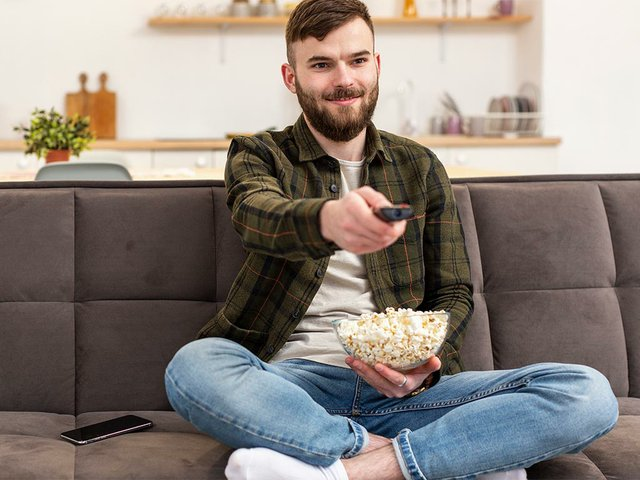 portrait-young-male-enjoying-tv-break.jpg