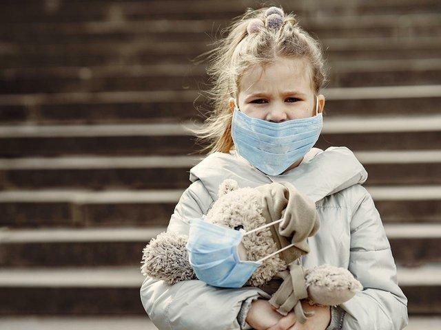 little-child-walks-outside-mask.jpg