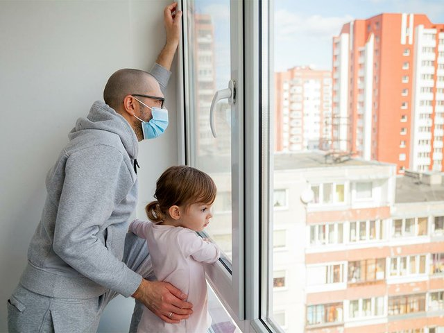 man-medical-mask-his-little-daughter-looking-outside.jpg