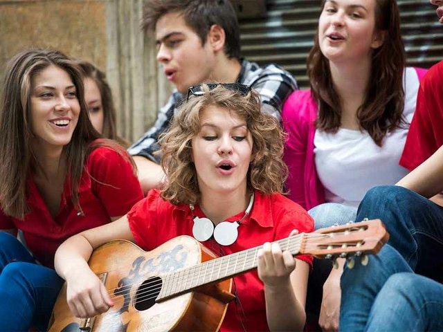 happy-teenage-girl-with-guitar.jpg