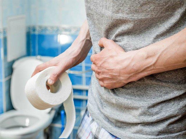 man-holds-toilet-paper.jpg