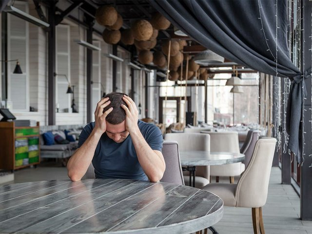 man-restaurant-director-is-holding-his-head-feel-worried-depressed.jpg