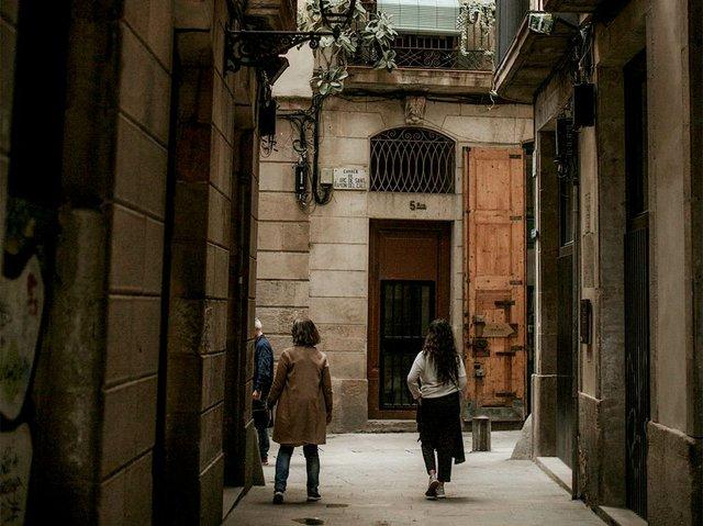 people-walking-in-a-narrow-alley-3916422.jpg