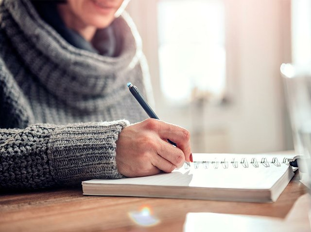 woman-writing-handwritten-will.jpg